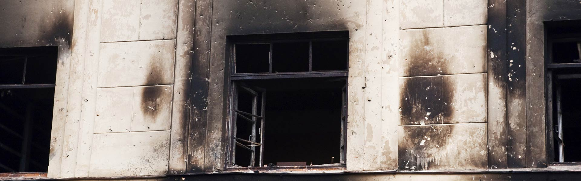 window with fire damage
