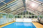 glass roofed swimming pool enclosure